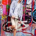 Boy with bike and graffiti