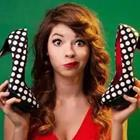 Girl holding black and white polka dot heels