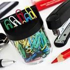 Colored paper clips and stapler