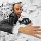 Man in piles of paper