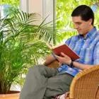 Man reading book in chair