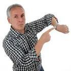 Man pointing to arm