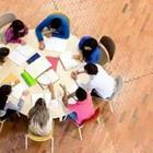 People Studying around Circle Table