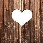 A brown wooden wall with a white heart in the middle