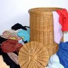 A basket filled with clothes around it