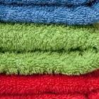A group of different colored towels