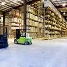 A big room holding stuff with a green cart