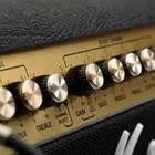 A row of gold buttons used on a music device