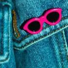 A blue background with pink sunglasses