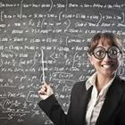 A woman with a pointer and pointing at a chalkboard with writing on it and wearing glasses