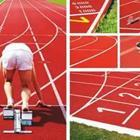 A person getting ready to run on a red track