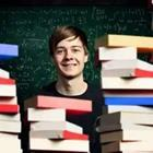 A person standing behind a pile of books