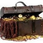 Treasure chest with gold inside of it