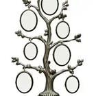 A picture frame in the shape of tree with ovals hanging off the side of it