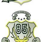 "An emblem with the number ""85″ on it"