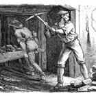 A black and white drawing of a man chopping at a wall