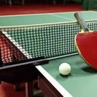 A green ping pong table with a net