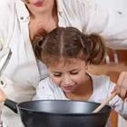 A child looking into a pot