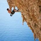 A person hanging on the side of a cliff