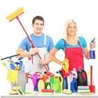 A man and woman with cleaning products in front of them