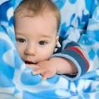 A baby in blue blankets