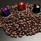 A bunch of coffee beans with three different colored objects on top of it