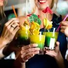 A bunch of people with colorful drinks in their hands