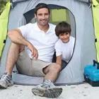 Father and son in tent