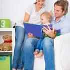 Mother and father reading book, story time
