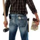 The behind of a man in jeans with a mallet