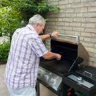 A man cooking on the grill