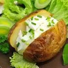 Sour cream on baked potato